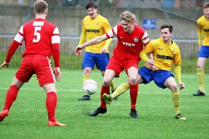 Dean Bown (centre, red) netted his seventh goal in five games to put YM 4-1 up at the break.