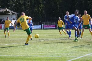 Herne Bay v Horsham. Chris Smith slots home his opener. Picture by John Lines