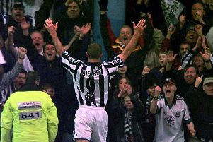 Shearer as he is best remembered - scoring for Newcastle