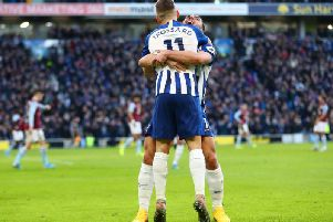 Leandro Trossard celebrates his opening goal with Neal Maupay